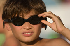 Kid with goggles ready to go for a swim stock photos