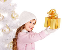 Kid with gold Christmas gift box. Stock Image