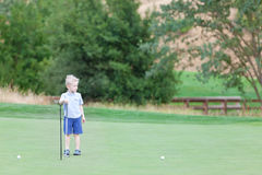 Kid at the golf course Royalty Free Stock Image