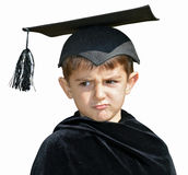 Kid graduate with graduation cap Stock Photo