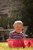 Kid in the grandmothers swimming pool stock photo