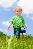 Kid in grass Royalty Free Stock Photos