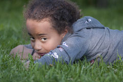 Kid in the grass. Sunset light was beautifully shining on the face of my friend's daughter Royalty Free Stock Images