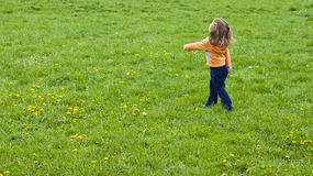 Kid in grass field. Photograph of kid, playing in grass field Royalty Free Stock Image