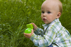 Kid in grass Stock Photography