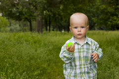 Kid in grass Royalty Free Stock Images