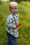 Kid in grass Royalty Free Stock Photography