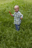 Kid in grass Royalty Free Stock Image