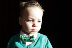 Kid in green cardigan and white shirt Royalty Free Stock Image