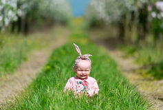 The kid in a green grass. Stock Image