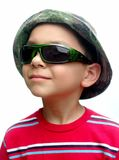 Kid with green sunglasses and camo hat Royalty Free Stock Images