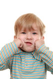 Kid grimaces Royalty Free Stock Photography