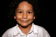 Kid with a grin. Portrait of a Young hispanic kid with a grin Stock Photo