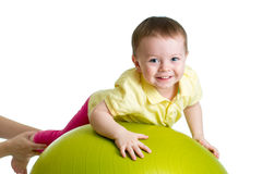 Kid on gymnastic ball Royalty Free Stock Images