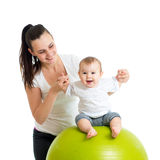 Kid on gymnastic ball Royalty Free Stock Photos