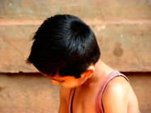 Kid Hairstyles. A oiled hairstyle of a kid from rural India royalty free stock photography