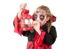 Kid in Halloween costume Stock Images