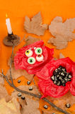 Kid Halloween party teats. Halloween party treats for kids, candy in spooky shapes Stock Image