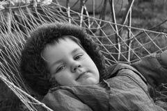 Kid in hammock Stock Images