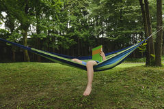 Kid on hammock with book Royalty Free Stock Photo