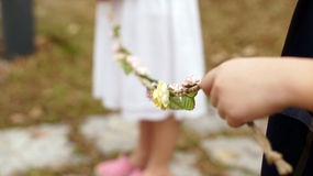 Kid hand holding a rope of flower for wedding Royalty Free Stock Photo