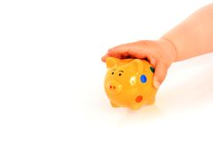 Kid hand and piggybank. Stock Images