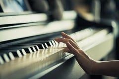 Kid playing Music keyboard closed up. Kid Hand playing Music keyboard closed up stock photo