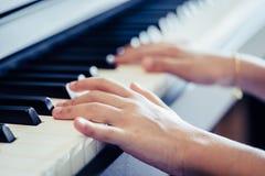 Kid Hand playing Music keyboard for music. Kid Hand playing Music keyboard for musioncept stock image