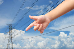 Kid hand point to the power electricity pole Royalty Free Stock Photo
