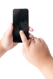 Kid hand touch on mobile smart phone with blank screen. Royalty Free Stock Photo