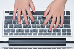 Kid hand typing on laptop keyboard Stock Photography