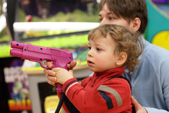 Kid with handgun Royalty Free Stock Photography