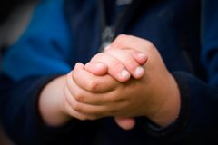 Kid Hands. Young Kid holding hands together Royalty Free Stock Images