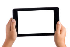 Kid Hands Holding Tablet Pc. Kid hands holding seven inches tablet pc in landscape position with blank white screen displayed towards the camera all isolated on royalty free stock photos