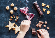 Kid hands reaching for sweets - happy childhood dream Stock Photos