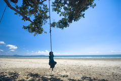 Kid hanging on rope Stock Image
