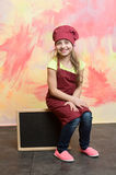Kid, happy girl cook in red chef hat, apron Royalty Free Stock Photography