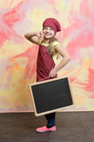 Kid, happy girl cook in red chef hat, apron Stock Images