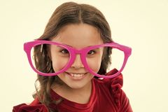 Kid happy wear cute eyeglasses accessory. Child charming smile isolated white background. Girl wear big funny eyeglasses. For party. Child cute face with stock photos