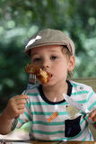 Kid has chicken Royalty Free Stock Image
