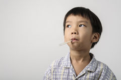 Kid has a herpes on mouth and measuring the fever Royalty Free Stock Photos