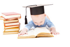 Kid in a hat of the bachelor. And the book. Concept of early education stock photos