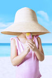 Kid with hat enjoy ice cream at shore Royalty Free Stock Photography