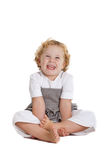 Kid having fun. Cute young girl of three having fun sitting on the floor Royalty Free Stock Photo