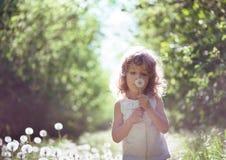 Kid having fun outdoors Stock Photo