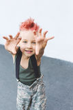 Kid having fun outdoors..A little boy with red hair Child in uniform. Stock Photos