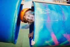 Kid having fun and playing in plastic tubes, as adventure activity Royalty Free Stock Images