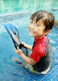 Kid having fun in the pool Stock Photography