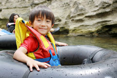 Kid having fun in the river Royalty Free Stock Photos