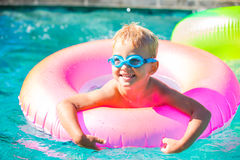 Kid Having Fun in Swimming Poo Stock Photos